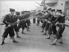 "Rifle drill; sailors facing each other whilst standing in the ""on guard"" position during practice on board HMS RODNEY."