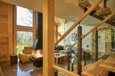 This custom home is a beautiful blend of classic and modern. The open plan, open-to-below loft, fireplace design, glass railings, the airy feel and the ultimate view makes this the perfect retreat. #TimberBlock #TimberBlockHomes #cottage #retreat #cottagelift #cottageliving #dreamhome #lakefront #mountainview #sustainability #sustainableliving #netzero #homebuilders #customhome.     #TimberBlock #sustainability