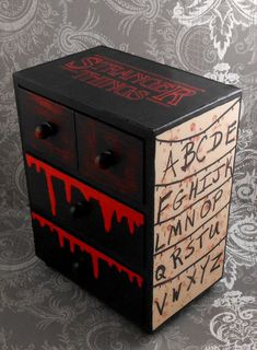Stranger Things - Red and Black - Stash Jewelry Box This item is made to order. Please allow 5 to 7 days for this item to be made. Four drawer decoupaged jewelry box. Both large drawers have a waffle pattern inside. Box is 7 1/4 inches tall, 6 inches wide, and 3 inches deep. Has a satin