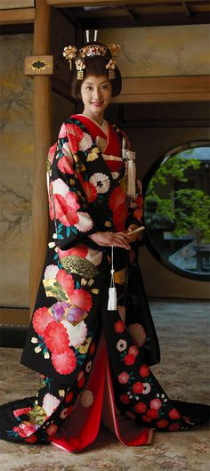 Japanese woman sporting the national women's dress of Japan.    so pretty
