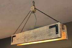 Great looking wood beam chandelier with pulley & chains. Available in many different finishes and sizes. A