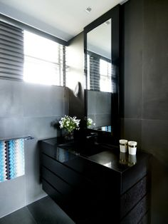 The perfect black bathroom vanity space?  The Missoni hand towels are a great addition to black.