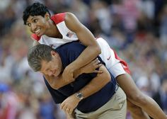 United States' Angel McCoughtry jumps on the back of United States coach Geno Auriemma following their win over France in the women's gold medal basketball game at the 2012 Summer Olympics, Saturday, Aug. 11, 2012, in London. (AP PhotoEric Gay)
