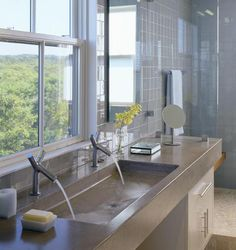single large integrated sink with dual faucets  interior design bathroom modern contemporary