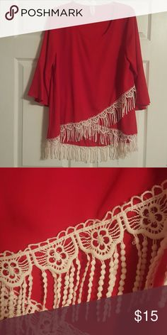 Red blouse with lace/fringe detail Red poly blouse with white lace and fringe trim along hem. Size xl. Worn once. Moa Moa Tops Blouses