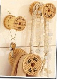 Spools as hooks. Would be cute painted perfect for the craft room!
