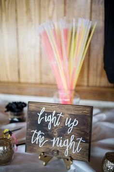 Glow sticks are always a fun addition to weddings. Jennette's Pier Wedding / Outer Banks Wedding / Photo by Courtney Hathaway Photography #jennettespierwedding #outerbankswedding #jennettespier #obx #nagsheadwedding