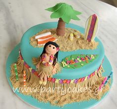 I love how the hula girl is perched on the cake. Exactly what I was thinking for Lilly's cake.