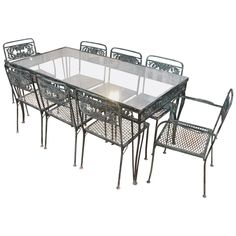 Vintage 1950s Wrought Iron Garden Set with Two Tables and Eight Chairs | From a unique collection of antique and modern garden furniture at https://www.1stdibs.com/furniture/building-garden/garden-furniture/