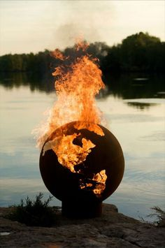 I want to watch the world burn, I really do. (3rd Rock from the Sun: Stylish Fire Pits Shaped Like the Earth)
