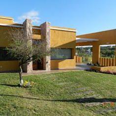 CASA DE CAMPO LOMAS DEL REY: Casas de estilo moderno por ART quitectura + diseño de Interiores. ARQ SCHIAVI VALERIA