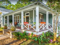 Love this porch. So many different spots to admire the garden from.