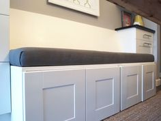 They used IKEA cabinets for the base! Awesome idea. I'd think it would be much less likely to chip than diy painted wood.  DIY Upholstered Banquette Seat