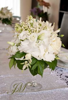 White table arrangement perfect for wedding, first communion or baptism. Liliac, hydrangea, lisianthus, astilbe, spray roses and foliage.