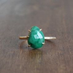 Hannah Blount Emerald Ring Set in 14k Gold. 2.5ct emerald prong set in 14k gold, size 7.5. Available at Meeka Fine Jewelry.