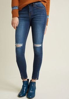 ModCloth Doing Up Distressed Skinny Jeans in 13, Affiliate, Go all in with giving your outfit an edgy twist through these stretch skinny jeans! A versatile mid wash, distressing at the knees, and twisted vents at each hem provide this pocketed pair with stylish appeal, so you'll have an absolute blast teaming them up with both your casual and classy pieces.