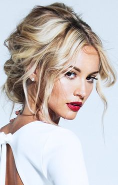 Messy up do and red lips.