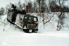 US Marines in a Norwegian Bv 206 traveling through snow