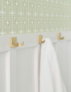 I added brass robe/towel hooks to the board and batten opposite the toilet/sink. When they arrived they were too dull so I lightly sprayed them with Krylon's Gold Leaf spray paint to brighten them up.