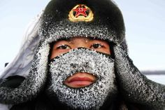 Frost covers the mask and part of the hat of a soldier of the People's Liberation Army (PLA) as he stand guard near the border of China and Russia in Heihe, Heilongjiang province. The local temperature reached -32 degrees Centigrade (-25.6 degrees Fahrenheit) on Wednesday.