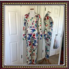 """NWT slightly stretch 2pc blouse & pants Got as a gift. Too small for me. Beautiful & smooth floral comfy slightly stretch. SKINNY PANTS; has  side zip.Length from waist to bottom 38 1/2"""". Rise 10"""". Waist Mark size S w/c has 29""""relax measurement. Hips 37"""" Relax measurement. Thigh 11""""across relax measurement. Hem 7 1/4""""across relax measurement. CROP LONGSLEEVE TOP: body length from neck to bottom 16 3/4""""; sleeve length 25""""; armpit to armpit 18"""" across relax measurement & to stretch all the way…"""