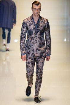 SPRING 2014 MENSWEAR Gucci /  Motherhood has transformed Frida Giannini. She glowed when she took her bow today. And she looked taller.The first outfit on the catwalk—a floral print tee, matching leggings, and a backpack—sent a message mixed enough to suggest that Gucci itself had taken an equally transformative turn: younger, clubbier, more athletic. First impressions are usually quite accurate. The collection that followed was a new direction for the label.