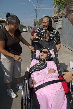 Trapped in bed for more than 30 years, Didina receives a wheelchair from Wheels for the World and is able go outside for the first time!