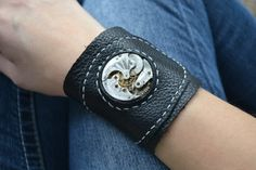 Leather cuff bracelet with 1891 vintage Elgin watch movement