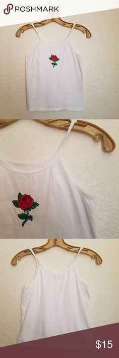 Rose embroidered tank Slightly cropped tank with rose embroidered patch.  Totally on trend for summer, pair it with some high waisted cutoffs and you're ready to go!  ***Tag is marked medium but fits like a small*** Tops Crop Tops