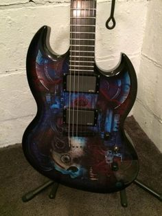 Vampire Skull Graphic ESP SG Viper Biotech Limited Edition Custom Graphics Guitar EMG SALE!!! LVIPERVBT NEW WITH FACTORY WARRANTY! Limited-edition Vampire Bio-tech Graphics Want an axe with a sinister vibe? The ESP LTD Viper Vampire Bio-tech solidbody electric guitar delivers sinister and so much more.