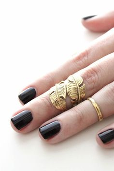 Ring a tad too small? Make a statement and turn it into a mid-finger ring above the knuckle.