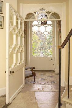 creamy white hallway, stone floors