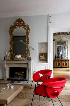 red, gilt and herringbone floors classic tolomeo on mantle and a flos fixture in the background - who could ask for more? (interior design, home decor)
