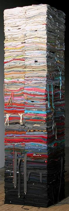 800 lbs. of carefully folded, second hand clothing, crisscrossed around a central spine