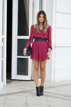 deep red dress dripping with embellishments; wide belt & black leather booties.
