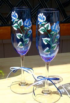 Blue Champagne Glasses With Hand Painted Roses by ipaintitpretty, $25.00  #paintdchampagneglasses #paintedblueglasses #bluerosesglasses