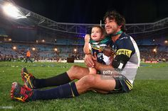 Cowboys captain Johnathan Thurston takes a moment in the centre of the field with his daughter Frankie Thurston after winning the 2015 NRL Grand Final match between the Brisbane Broncos and the North Queensland Cowboys at ANZ Stadium on October 4, 2015 in Sydney, Australia.