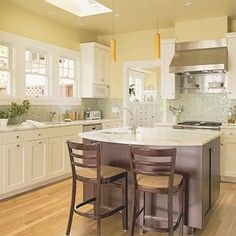Cream Colored Kitchen Yellow Walls Light Counters Wood Floors Hood
