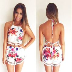 Product Description: Women Sexy Casual Two Pieces Set Halter Sleeveless Backless Lace Trimming Crop Tops Flower Print Fringe Shorts. Beautiful flower print. Halter, sleeveless, backless, short sexy cr