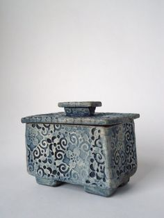 This Asian style box has a cork lined lid that sit securely in place. The perfect box to hold your keepsakes.    measures 3.5 x 2.5 x 3    Raku is a alternative firing technique where clay pieces are pulled from the kiln while glowing red hot (about 1800◦F). They are placed in a metal