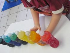 Rainbow bottles - we simply filled the bottles about 3/4 of the way with water, added about 1/2 cup of cooking oil, and then added a few drops of food color. Then we used hot glue to permanently attach the lids so they wouldn't open up while the children played….add the name of the color to each bottle and put in the science center.