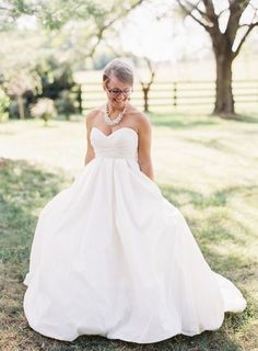 David's Bridal bride Bethany wore this pleated strapless sweetheart neckline ball gown wedding dress by David's Bridal for her elegant rustic wedding! | Michael and Carina Photography
