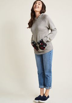 <p>When it comes to all of the adorable details this grey pullover has to offer, what's not to 'glove'? A cozy hood kicks things off with this ModCloth namesake label sweater, but it's the long sleeves, dark mitten pockets, and colorful pom-poms of this snuggly piece that really steal the show!</p>
