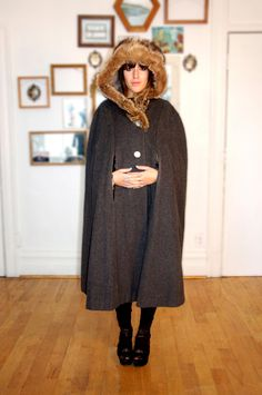 Grey wool cloak with FULL fur lining, massive hood and a ornate button. This whole thing is ornate.. $215.00, via Etsy.