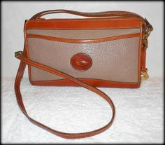 'Dooney&Bourke Rare All-Weather Leather Vintage X-Body' is going up for auction at  8pm Mon, Apr 21 with a starting bid of $20.