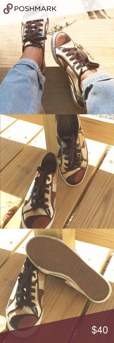 Casual Sneakers!! READ DESCRIPTION!! Casual Coach sneakers in a satin finish!! Perfect colors to transition to the fall season! Gently used condition!! These do run big so they would fit a women's 7-71/2 just fine! Open to offers!! Coach Shoes Sneakers