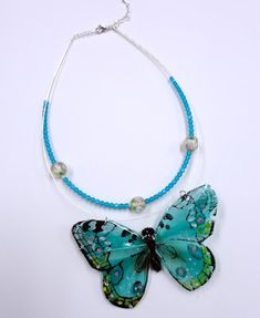 resin-covered dollar store butterfly - made into a necklace