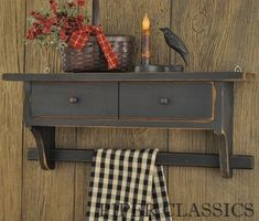 <p>Berkley Shelf with Towel Bar Black - Our USA made wood shelf with towel bar and two drawers is great for displaying favorite items and practical for hanging kitchen towels. Measures 23 inches wide, 6 inches deep and 10 inches high. Time worn black distressed finish.</p>