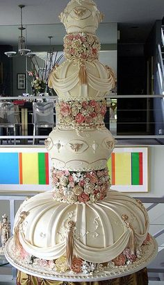 "Big 'Age Of Reason ' cake -     Here we see the 60"" tall wedding cake , with the 36 "" base board, displayed on the 24"" unstable table."