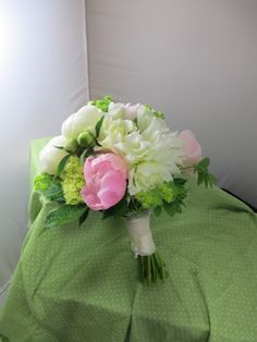 Soft pink and white bridal bouquet. Locally-grown peonies and dahlias. Tied off in ivory ribbon. Mid June.